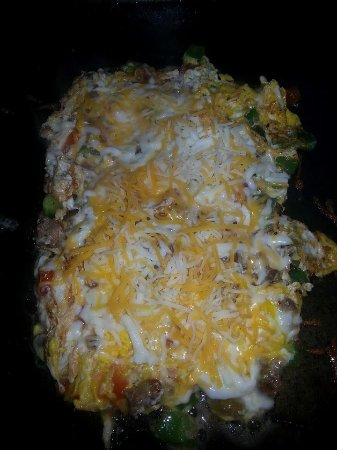 Cotter, AR: Our version of an omlette you pick your toppings we sautee them up and mix it all together