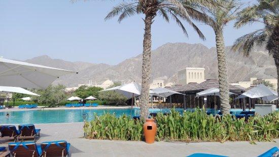 Miramar Al Aqah Beach Resort Pool With The La Cucina Italian Restaurant On