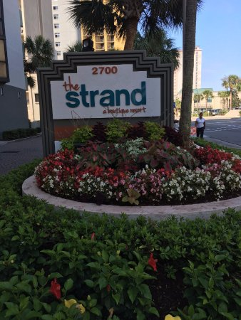 The Strand A Boutique Resort: Outdoor Landscape and Sign
