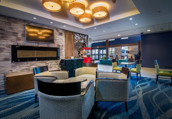 Maplewood Suites Extended Stay - Syracuse/Airport: Breakfast area with a variety of seating, two flat screen tvs and fireplace.