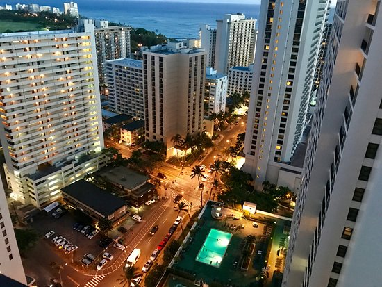 Waikiki Banyan : View of the 6th floor recreation/pool deck and street below from the room