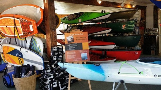 Center Harbor, NH: A shop full of sparkling new Paddle Boards, Kayaks and Canoe