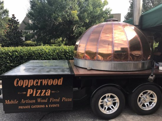 Eatonton, GA: The wood fired oven is parked in front of the restaurant. Straight from the oven to your table.