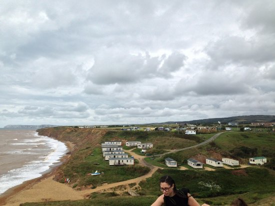 Brighstone, UK: View from coastal path looking at the site, mobile homes - lower level and tents on top of cliff