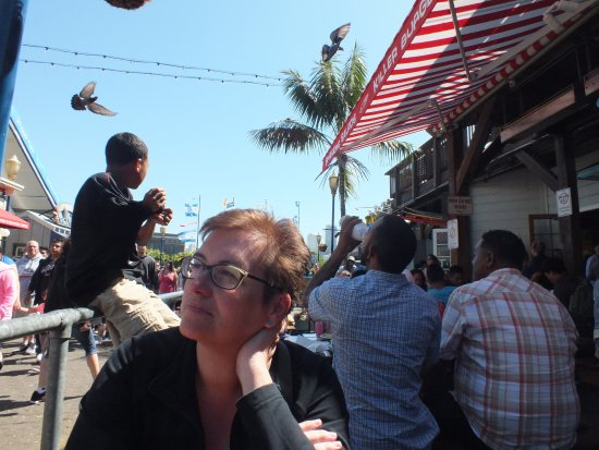 Wipeout Bar & Grill : My wife at our table waiting for our food whilst enjoying the movement around us