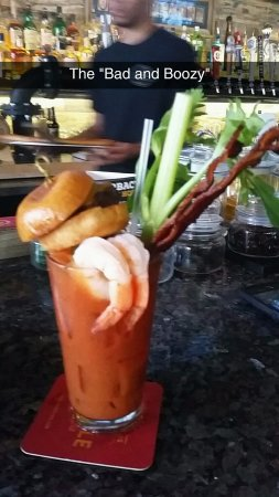 South Houston, Техас: The new Bad and Boozy Bloody Mary at On the Kirb. Yes, that is shrimp, bacon strips, and a slide