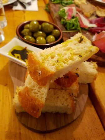 The Herd Steak Restaurant Focaccia Bread And Olive Oil Dipping Sauce