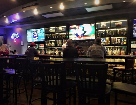 the tailgate sports bar grill share a beer with a friend while you catch