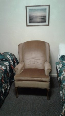 The Cedars Motel: The only place to sit down was this tired old chair that was crammed between the two beds.