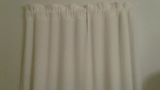 The Cedars Motel: Yes, they really are trying to pass off these towels as curtains.