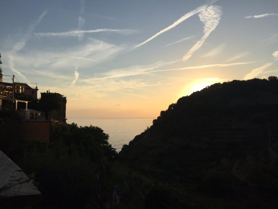Food and Sea: View of Mediterranean from the terrace tables at sunset