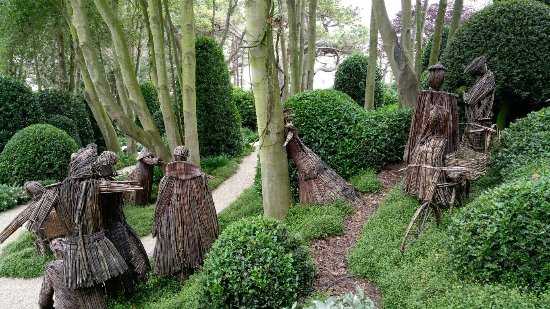 interesting wood stick sculptures in the gardens picture of les