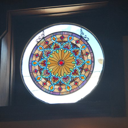 Stockton, IL: Beautiful stained glass mounted in circular as viewed from inside Stells's