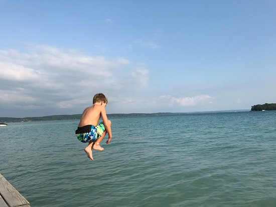 Elk Rapids, MI: Nothing better than the first jump in the lake!