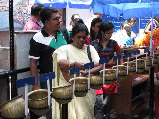 Shivoham Shiva Temple: devotees are given 108 coins to be dropped one-by-one in the 108 holy bowls chanting Om Namah Sh