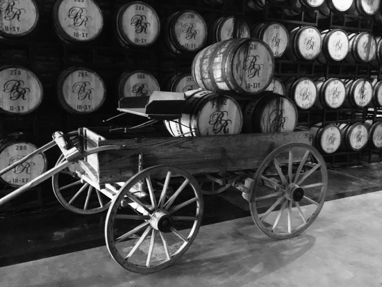 An old wagon with Richland Rum barrels in the barrel house