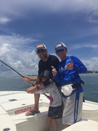 Another happy family fighting a Boca Grande tarpon. Capt. Chuck Jenks loves making lifelong memo