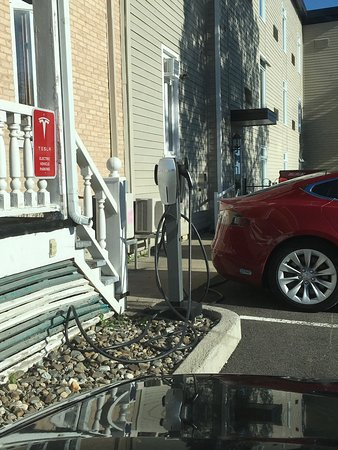 Auberge du Littoral: A Tesla charger. Don't know enough about EVs to know if it's compatible with other models.