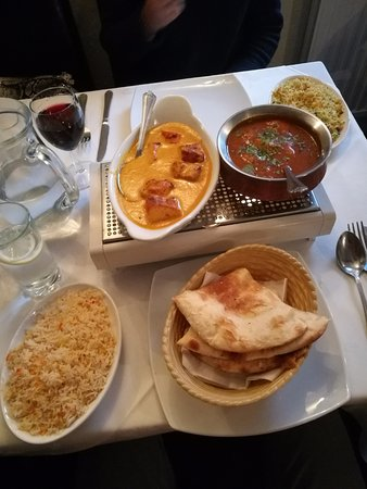 Chicken Madras, Chicken Korma, Pilau and Special Rice with Coconut and Garlic naan breads