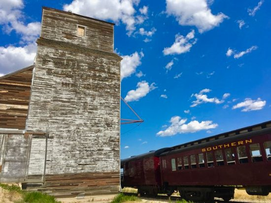 Surviving grain elevator at Horizon and carriage from Southern Prairie Railway tour