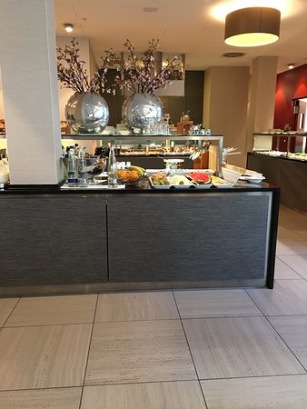 Breakfast buffet - huge selection of meats, cheeses, fruits, cereals, pastries, coffee, tea, jui