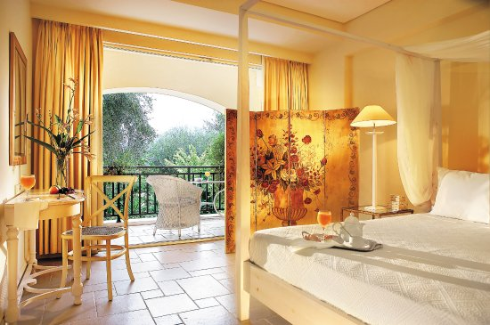Grecotel Eva Palace: Deluxe Bungalow Suite Garden View, A Romantic Canopy  Bed With Bleached