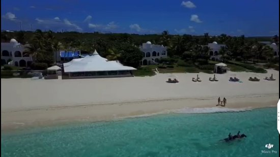 Paper Boat Charter: Us walking on the beach in Cap Juluca