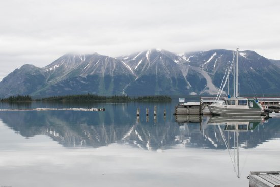Sailboat nestled at the foot of the glacier on Atlin Lake in British Columbia