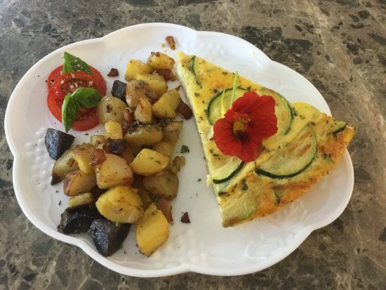 West Barnstable, MA: From our garden!  Zucchini frittata, sun-dried tomatoes and Asiago cheese + bacon home fries!