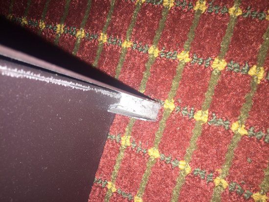 Super 8 Niagara Falls/Buffalo Area: SEE THE BED RAIL SHARP .It is lengthy and mattress was inside