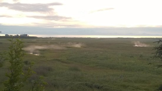 Anchor Point, AK: Our view of ocean from our RV spot with condensation rising from the creek.