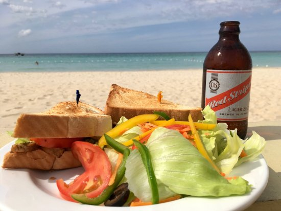 SuperClubs Rooms on the Beach Negril: A lovely grilled jerksandwich with local fresh veggies. A supersandwich on the beach with a cold