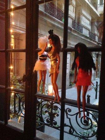 Alba Opera Hotel: crazy (creepy?) barbies hanging in the front window of Alba Opera