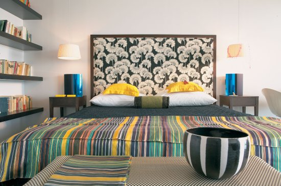 Vouliagmeni Suites: Deluxe Guestrooms Combine Luxurious Furnishings with Designer Fabrics in Cool Ivory Tones