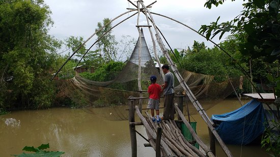 Travel Sense Asia: We even caught some fish using a BIG fishing net made by locals.