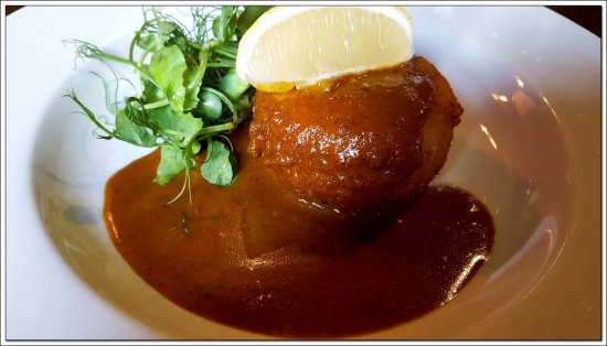 Stokesley, UK: A sumptious fish cake with an intense curry sauce