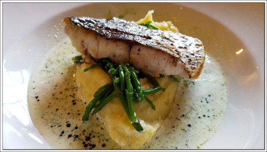 Crathorne, UK: The fillet of Stone Bass with Crushed potatoes and a buttery chive oil sauce