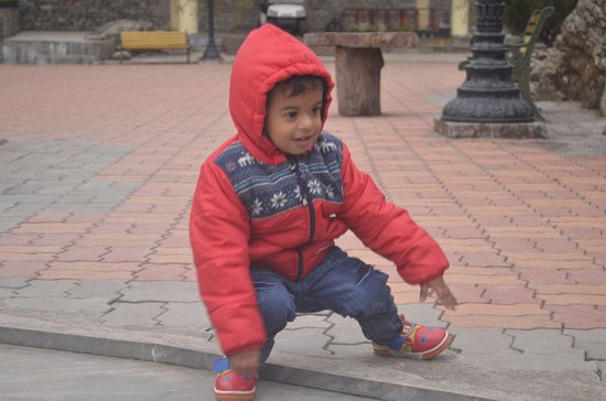 Bagdogra, India: My son Playing at the Rumtek Monastery, Sikkim.