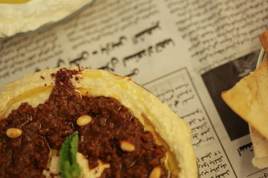 Hummus topped with Beef