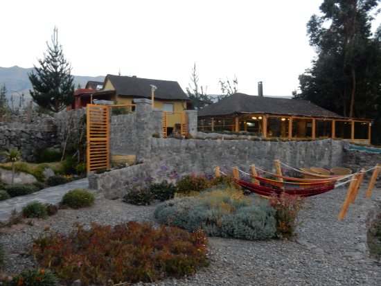 Killawasi Lodge: View of the restaurant (left) and the hammocks relaxing area