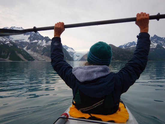 Alaska Fjord Charters: Paddling on tranquil waters with Northwestern Glacier in the background