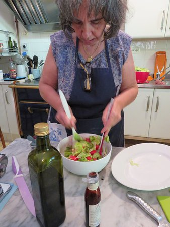 In Campagna Cooking Classes: Letizia mixing together the Panzanella