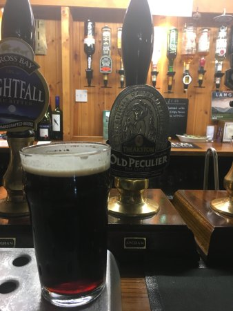 The Old Dungeon Ghyll Hotel : Old Perculier on the pumps