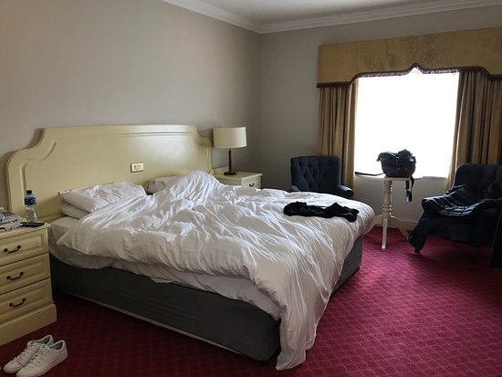 Midleton Park Hotel: Old unfurnished room compared to a newly refurbished room. How can they charge the same rate??