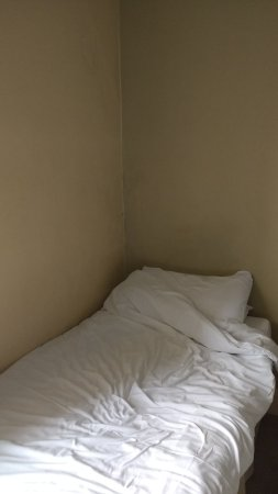 International Hotel: Typical single bed in a triple room