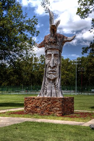 Floodwall Murals: Wacintin Statue made from a tree.