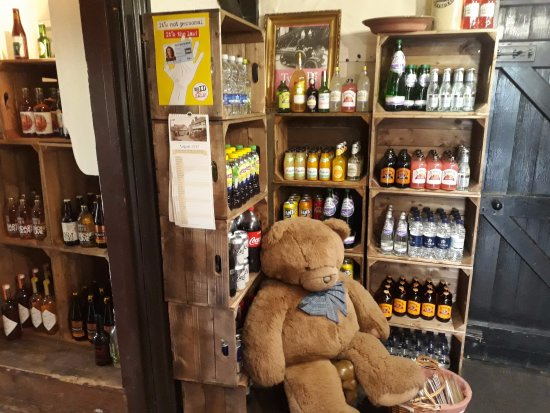 Pembridge, UK: Bottle shop and big teddy!