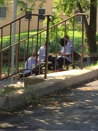Shepherdstown, WV: Housekeepers sitting on phones while smoking adjacent to guest parking.