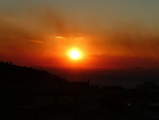 Cesare Augusto: rooftop sunset and skyline (smoke is from the forest fires on Mount Vesuvius)