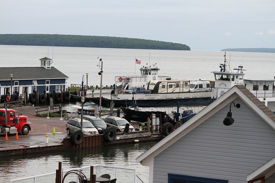 Bayfront Inn: View from back deck/stairs of Room #12 of the Madeline Island ferries and harbor.